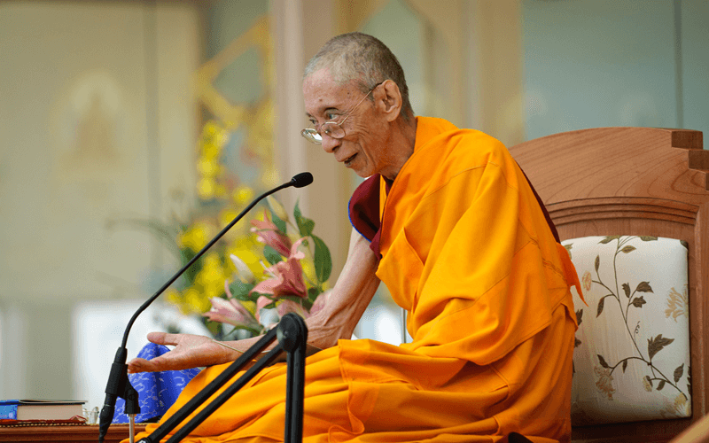 Venerable Geshe Kelsang Gyatso teaching in the world peace temple