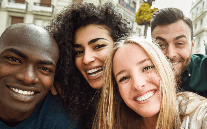 Group of mixed race people smiling